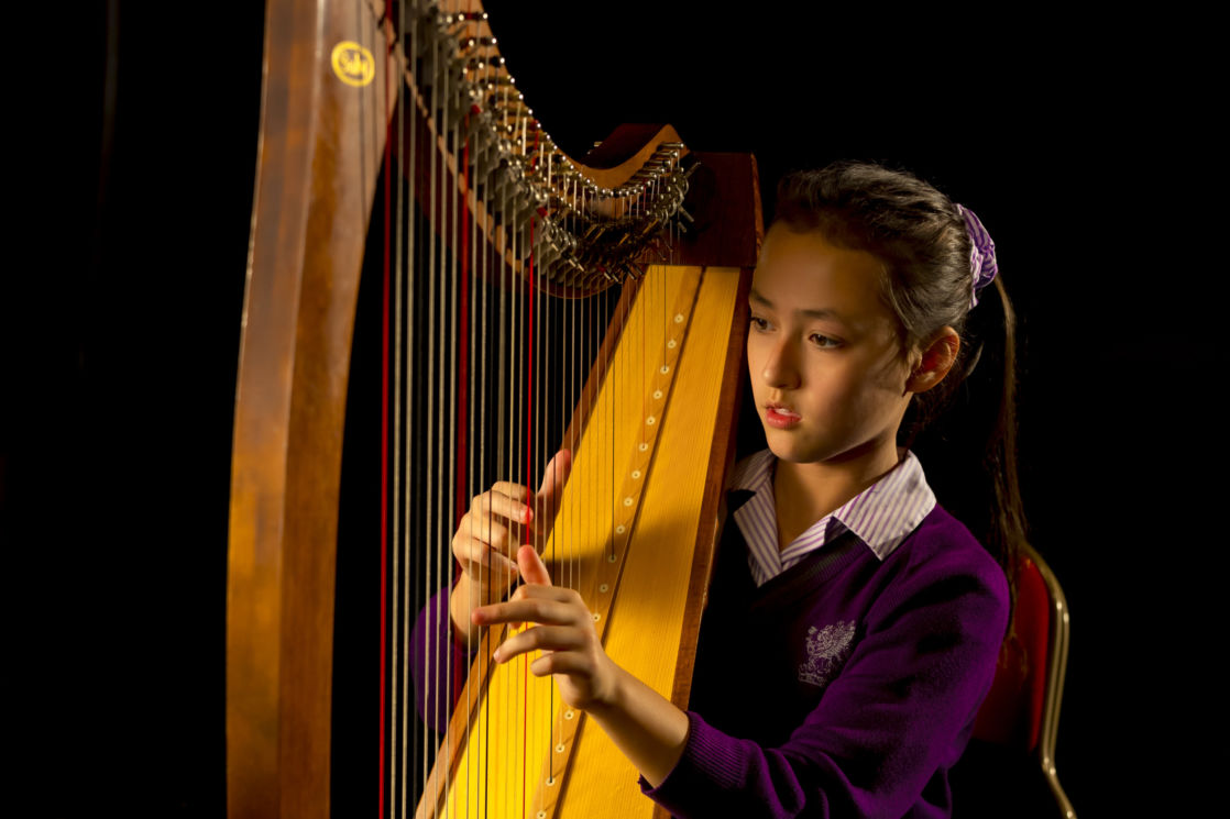 Wycliffe student play the harp music instrument