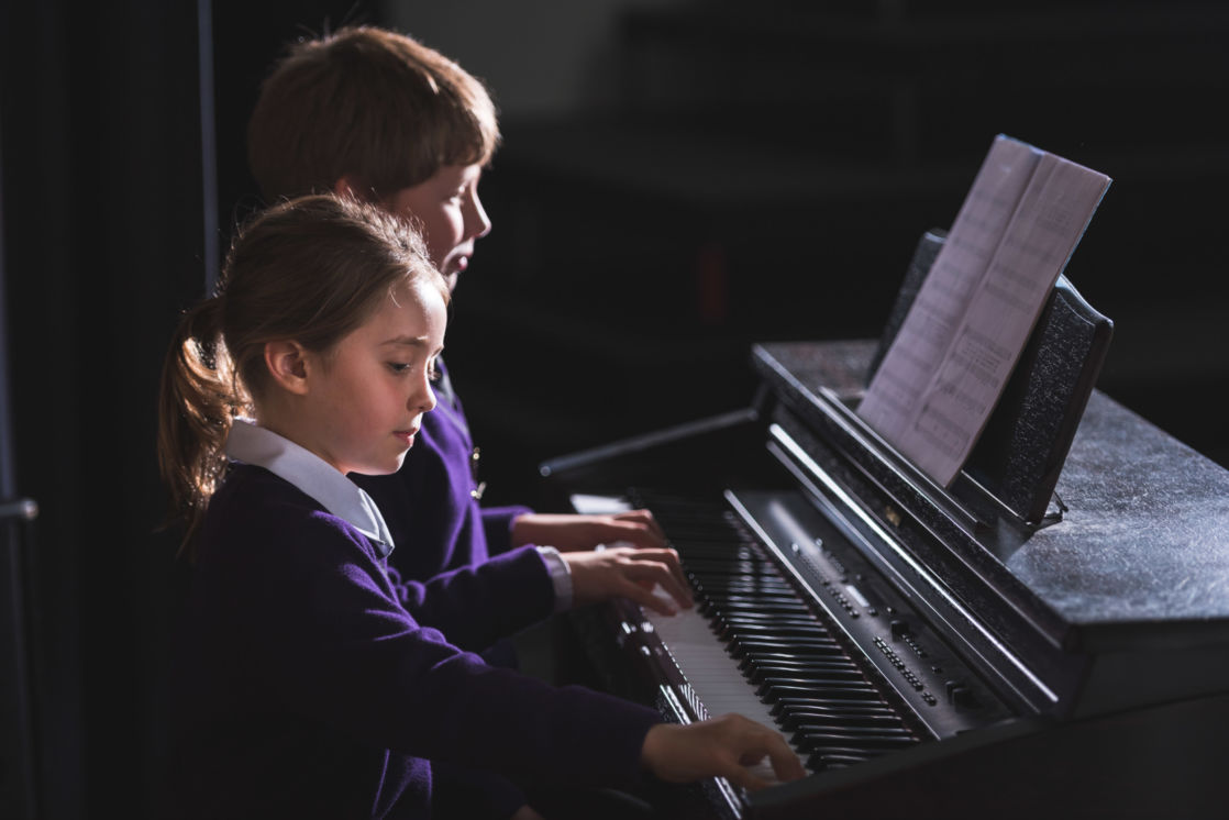 wycliffe kids playing the piano