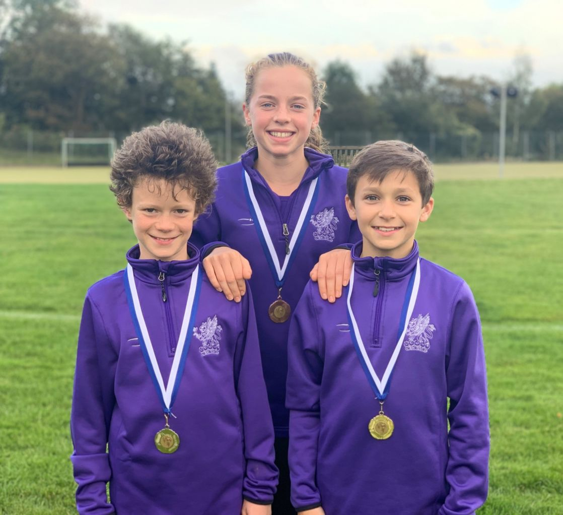 wycliffe pupils outdoors wearing medals