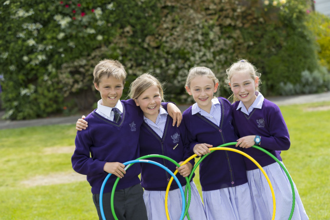 wycliffe kids posing with hula hoops