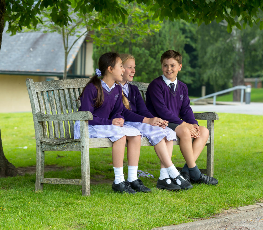 wycliffe pupils sitting on a bench