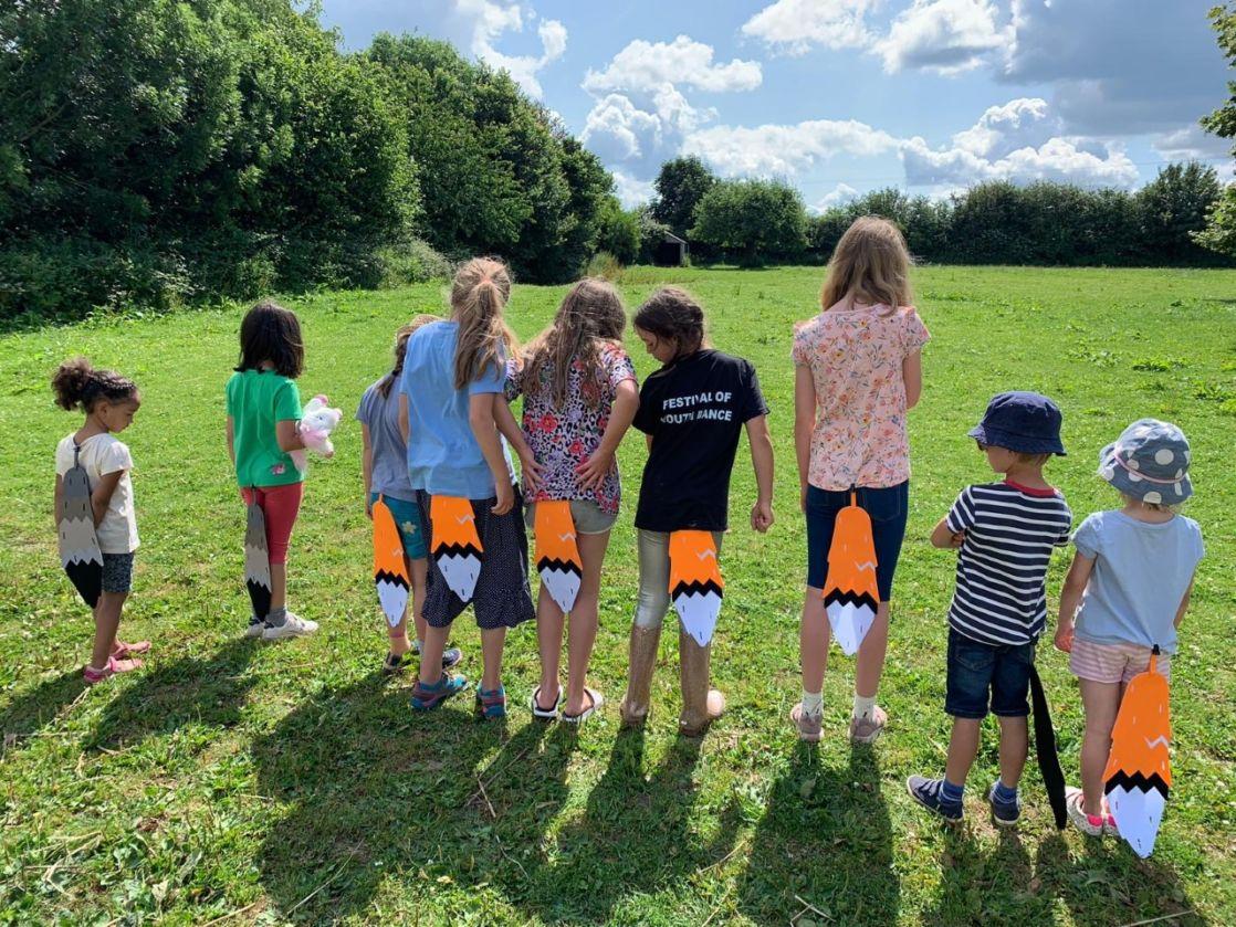 wycliffe kids wearing fox tails