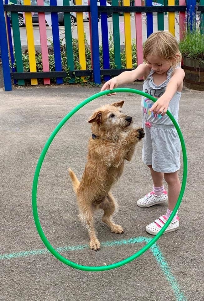 wycliffe girl and dog playing with hula hoop