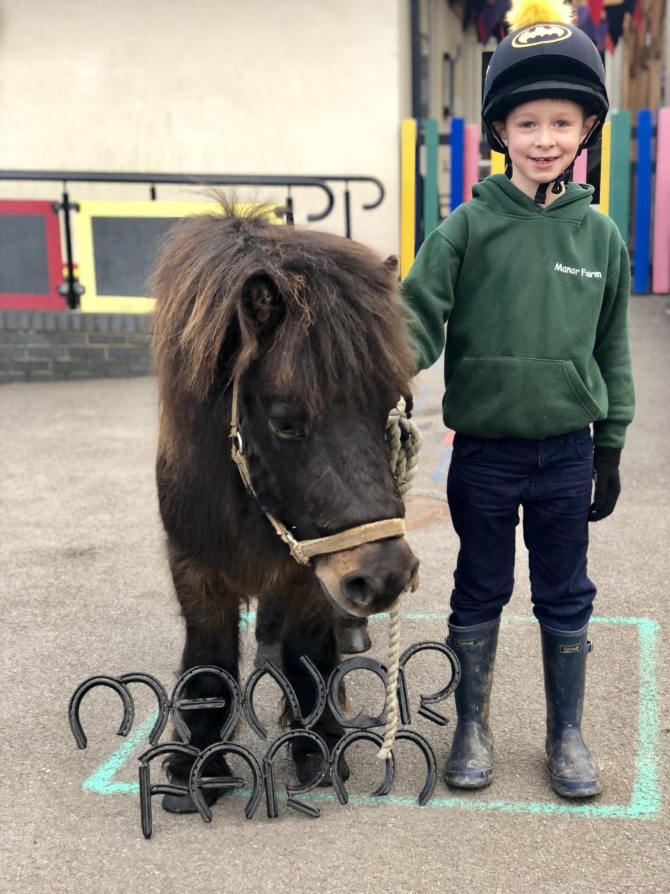 wycliffe boy next to a pony in Manor Farm
