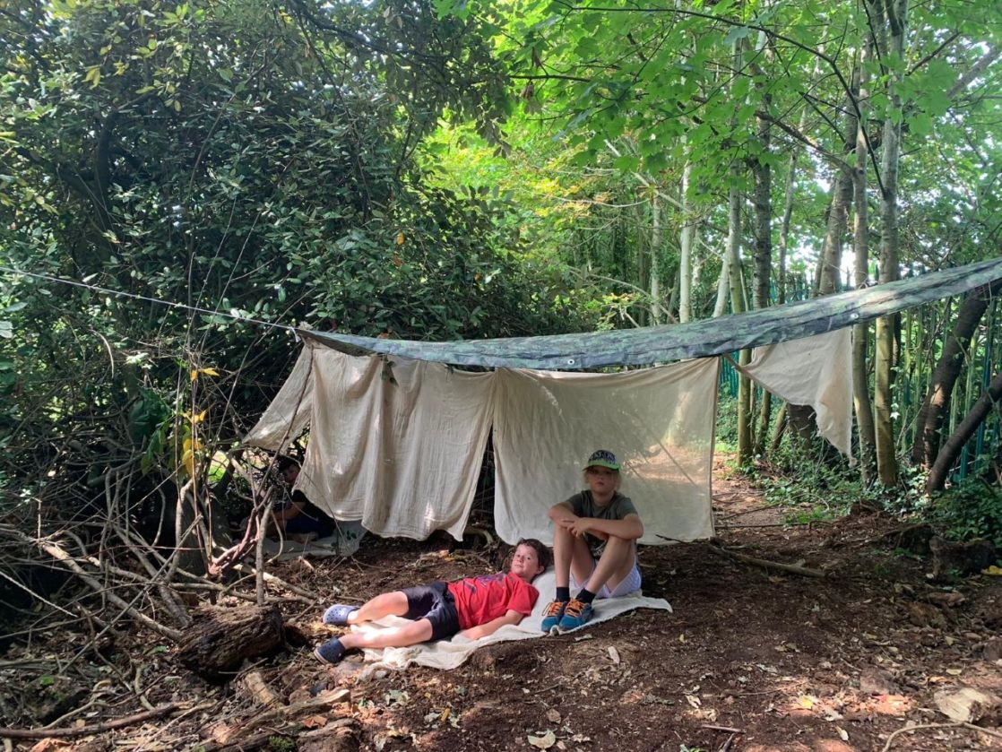 wycliffe pupils resting in the woods at Manor Farm