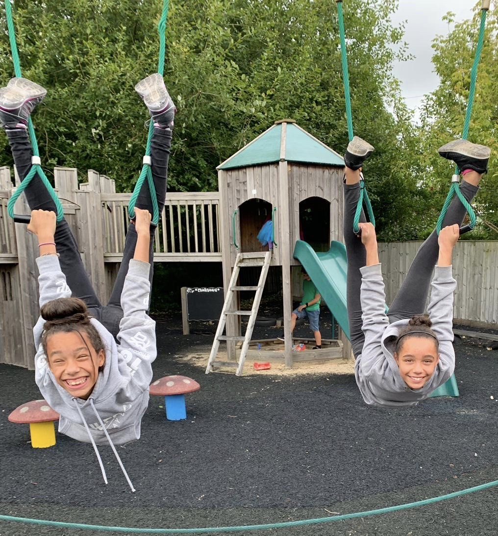 wycliffe girls playing in a swing