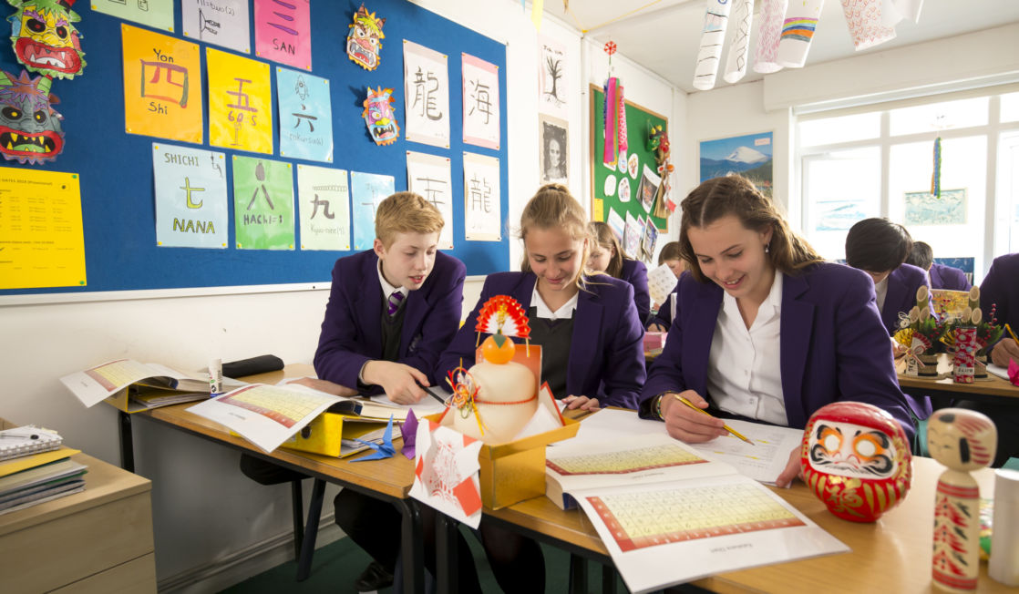 wycliffe pupils reading a book in class
