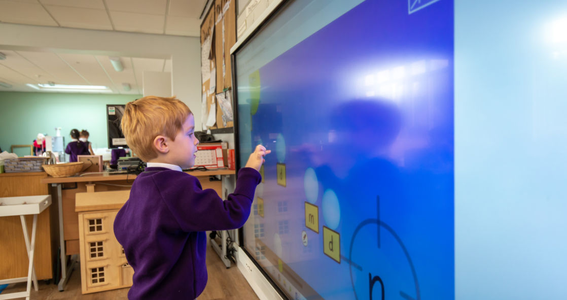 wycliffe pupil playing with smart board