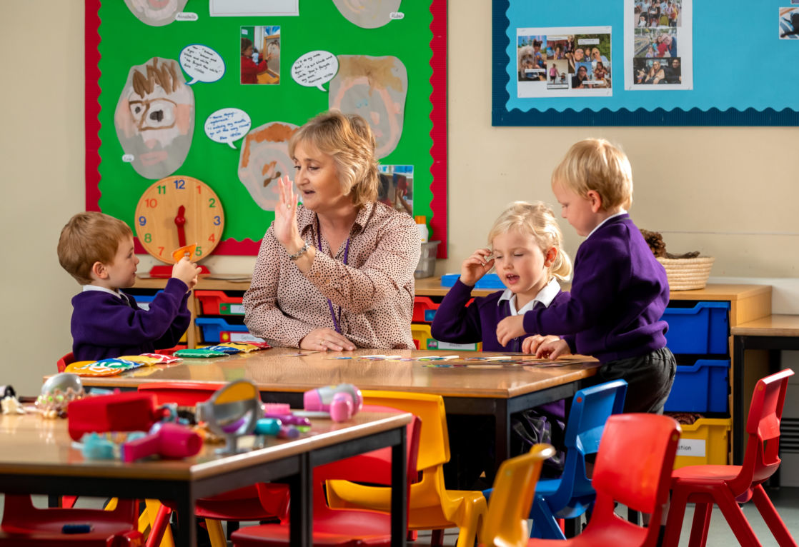 nursery wycliffe kids and teacher playing in class