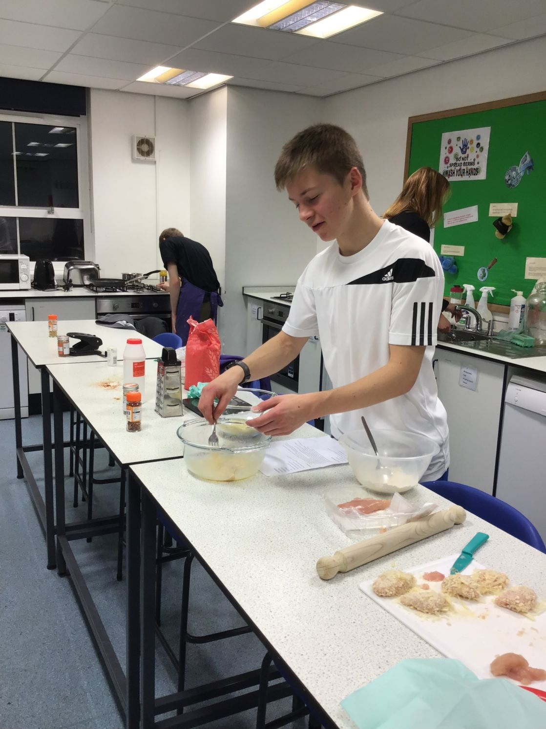 pupil cooking at cooking club at wycliffe independent school