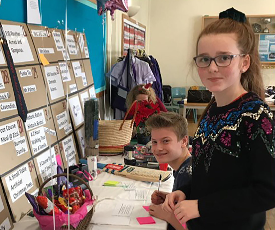 Toby and Alice organised an auction of promises at the Christmas Fayre